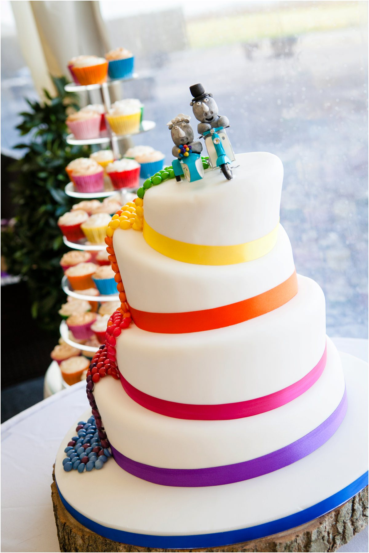 muti coloured wedding cake with white icing