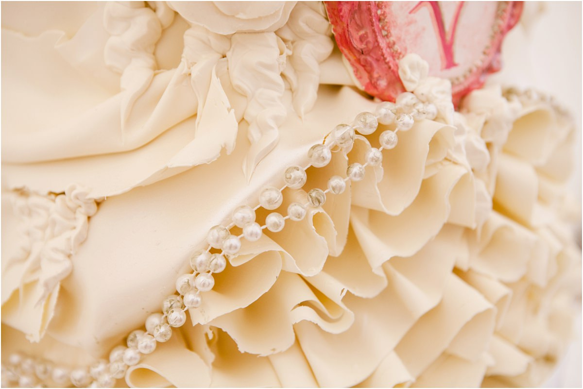 close up of wedding cake with pearl decoration