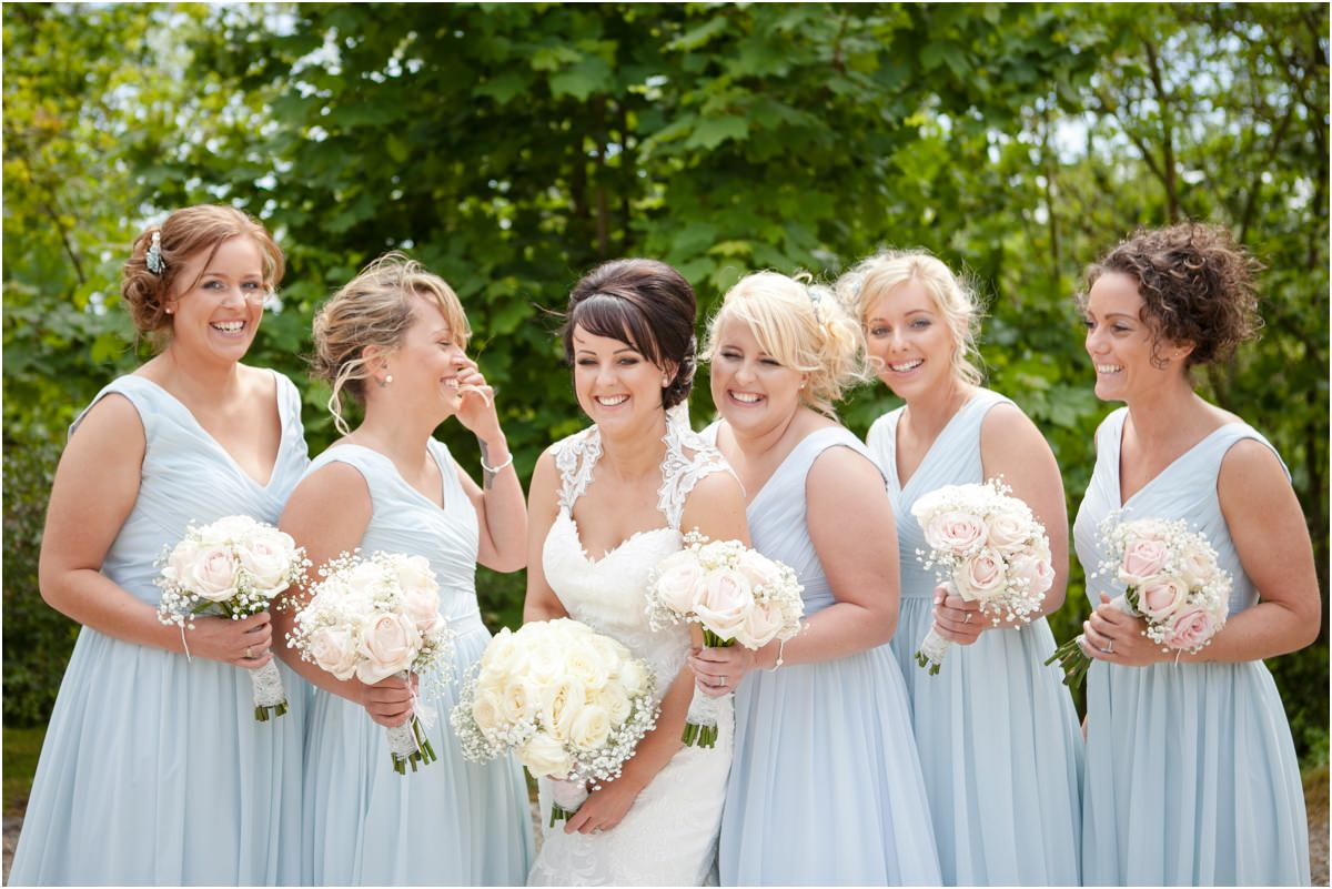 Bride and her bridesmaids laughing