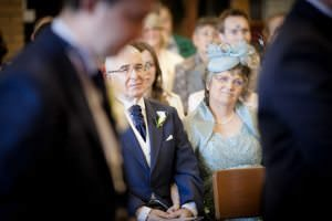 brides parents watching ceremony