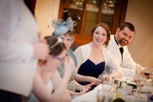 brides sister enjoying grooms speech
