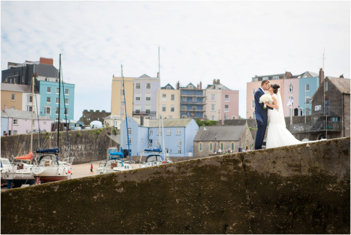 Bride and Groom on the slip at Tenby Harbour on their wedding day