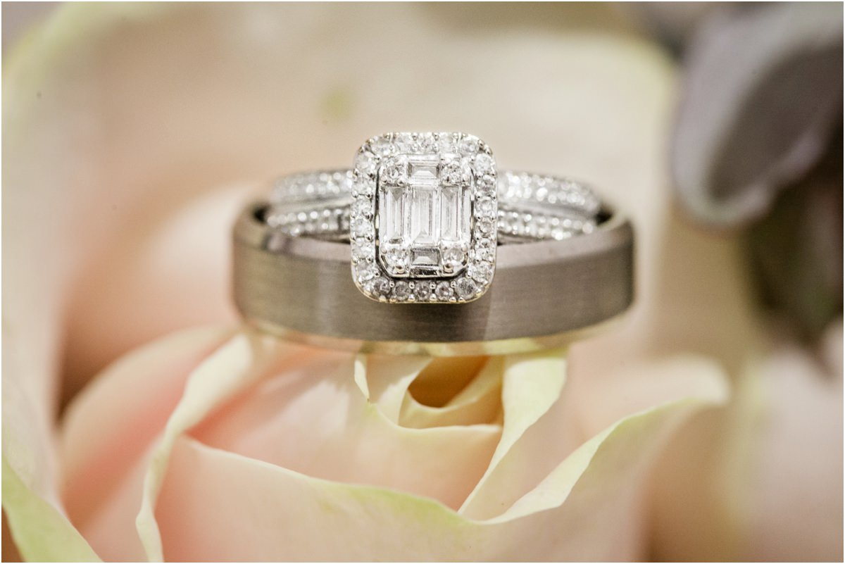 Wedding rings on a rose