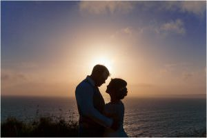 bride and groom at Sunset at Druidstone Hotel