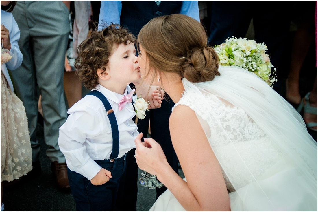 page boy kissing bride
