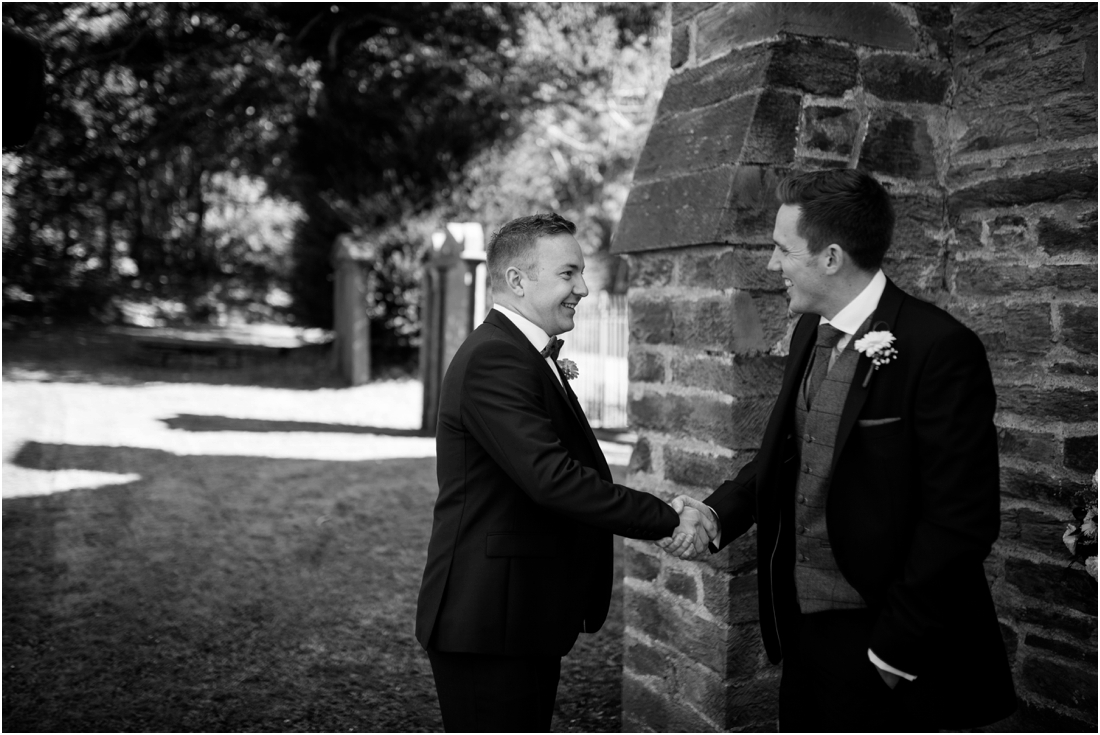 groom and best man shaking hands