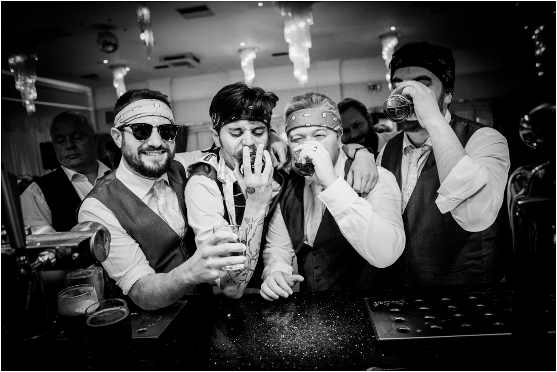 groomsmen doing shots