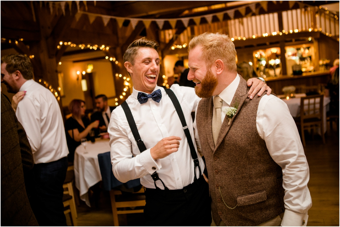 male wedding guests dancing