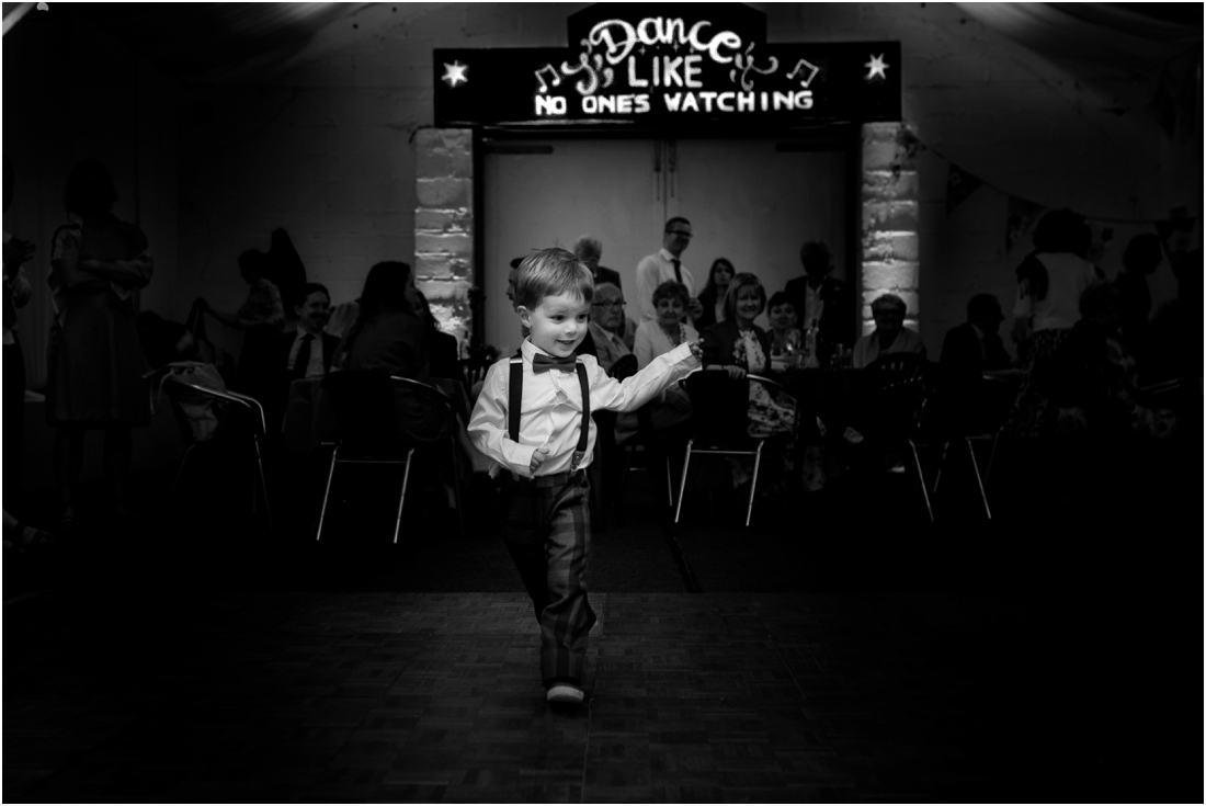 little boy dancing at wedding